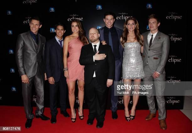 Director David Slade members of the cast Alex Meraz Booboo Stewart Nikki Reed Kellan Lutz Ashley Greene and Xavier Samuel as they arrive for the...