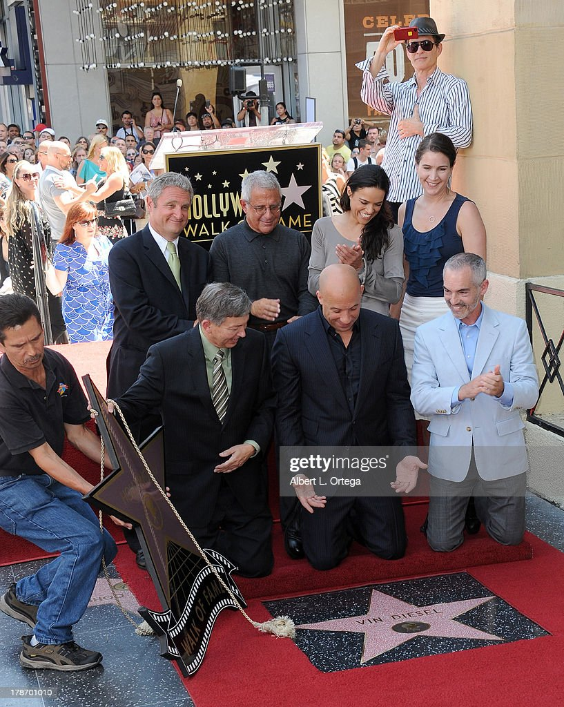 Director David Thwoy, Michael Green, Ron Meyer, actress Michelle Rodriguez, Leron Gubler, actor Vin Diesel and Mitch O'Farrell participate in the Star Ceremony for Vin Diesel on the Hollywood Walk Of Fame held on August 26, 2013 in Hollywood, California.
