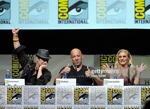 Director David Twohy actor Vin Diesel and actress Katee Sackhoff speak onstage at the 'KickAss 2' and 'Riddick' Panels during ComicCon International...
