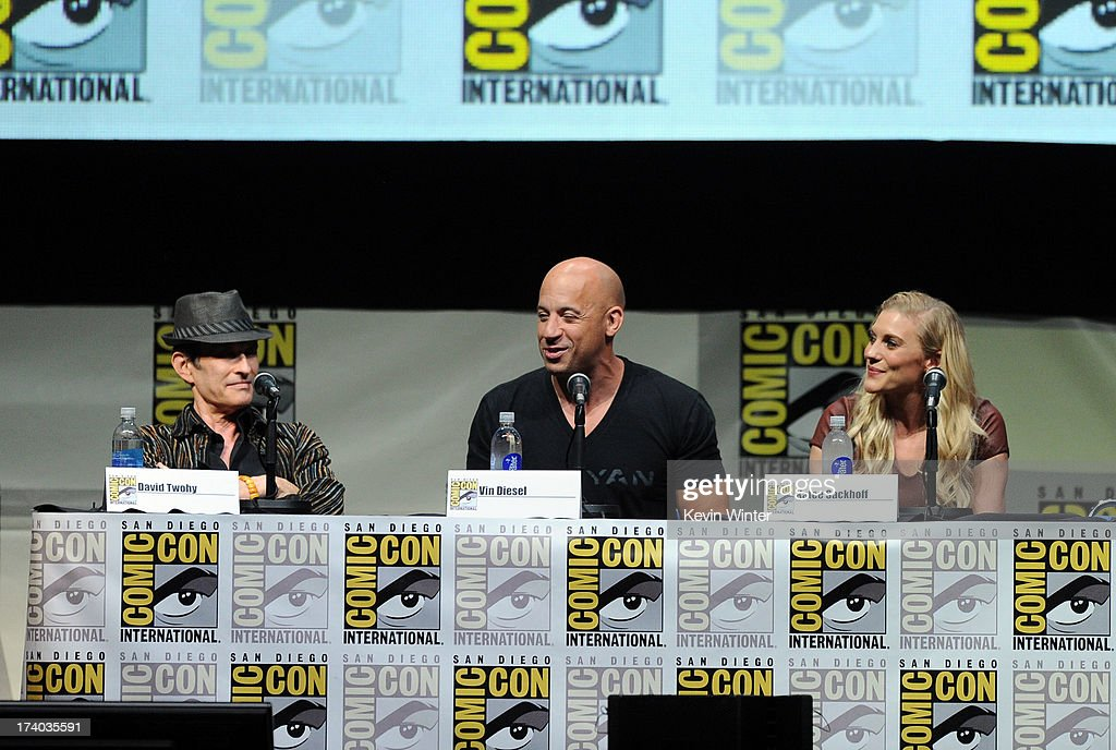 Director David Twohy, actor Vin Diesel and actress Katee Sackhoff speak onstage at the 'Kick-Ass 2' and 'Riddick' Panels during Comic-Con International 2013 at San Diego Convention Center on July 19, 2013 in San Diego, California.