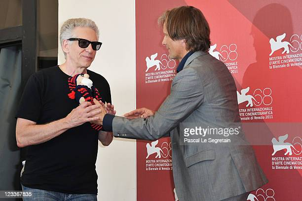 Director David Cronenberg and actor Viggo Mortensen pose at the 'A Dangerous Method' photocall at the Palazzo del Cinema during the 68th Venice Film...