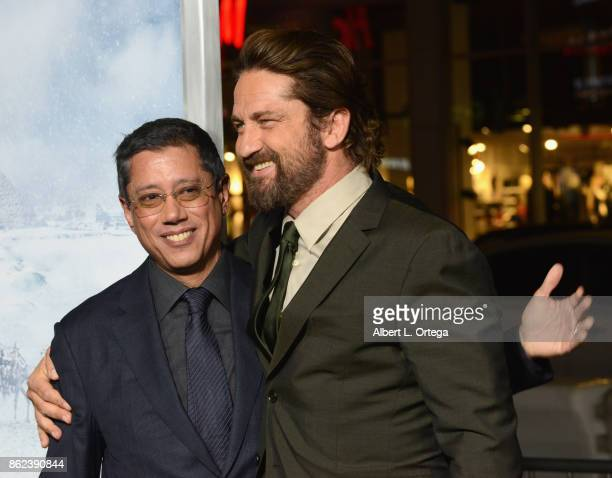 Director Dean Devlin and actor Gerard Butler arrive for the Premiere Of Warner Bros Pictures' 'Geostorm' held at TCL Chinese Theatre on October 16...