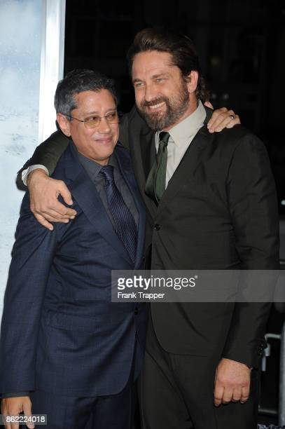 Director Dean Devlin and actor Gerard Butler attend the premiere of Warner Bros Pictures' 'Geostorm' on October 16 2017 at the TCL Chinese Theater in...