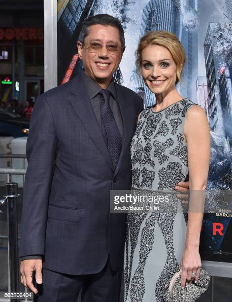 Director Dean Devlin and actress Lisa Brenner arrive at the premiere of 'Geostorm' at TCL Chinese Theatre on October 16 2017 in Hollywood California