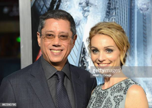 Director Dean Devlin and wife/actress Lisa Brenner arrive for the Premiere Of Warner Bros Pictures' 'Geostorm' held at TCL Chinese Theatre on October...