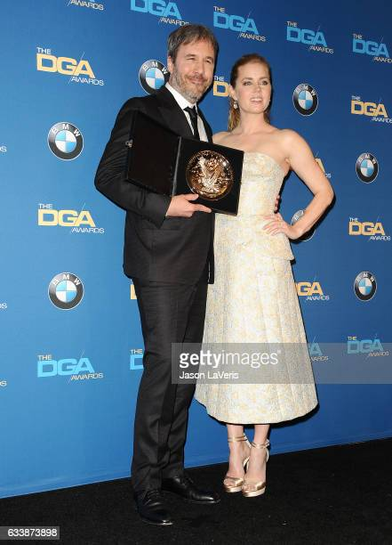 Director Denis Villeneuve and actress Amy Adams pose in the press room at the 69th annual Directors Guild of America Awards at The Beverly Hilton...