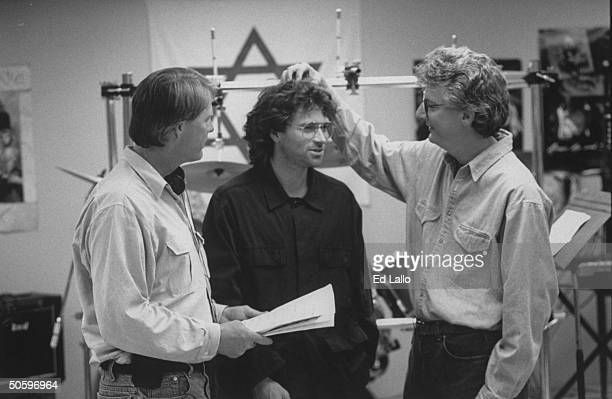 Director Dick Lowry actor Tim Daly and producer Ken Kaufman discuss an upcoming scene during a break in the filming of the TV movie 'In the Line of...