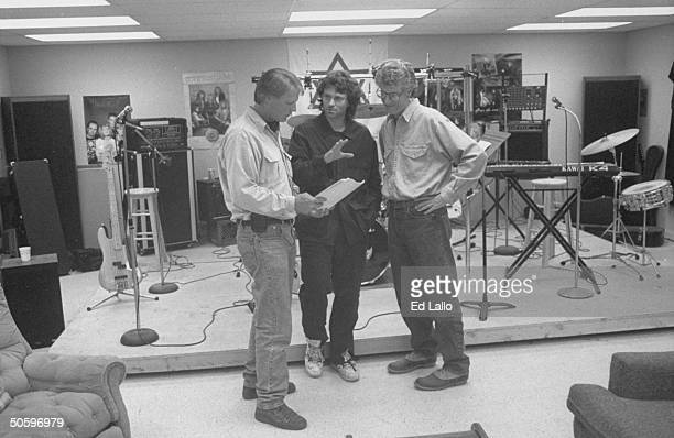 Director Dick Lowry actor Tim Daly and producer Ken Kaufman discuss an upcoming scene during a break in the filming of the television movie 'In the...