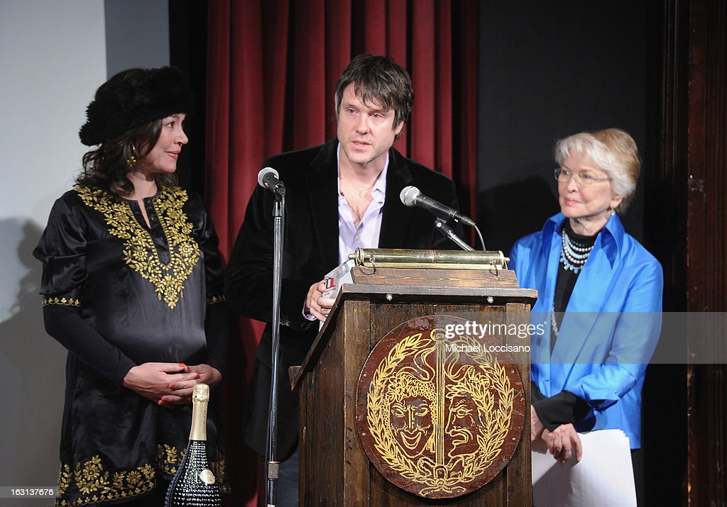Director Diego Rougier (C) and wife Javiera Contador (L) accept the Grand prize while Actress <a gi-track='captionPersonalityLinkClicked' href=/galleries/search?phrase=Ellen+Burstyn&family=editorial&specificpeople=216383 ng-click='$event.stopPropagation()'>Ellen Burstyn</a> looks on during the closing night awards during the 2013 First Time Fest at The Players Club on March 4, 2013 in New York City.