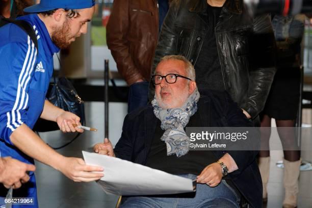 Director Dominique Farrugia signs autographs before 'Sous Le Meme Toit' Premiere at Kinepolis on April 3 2017 in Lille France