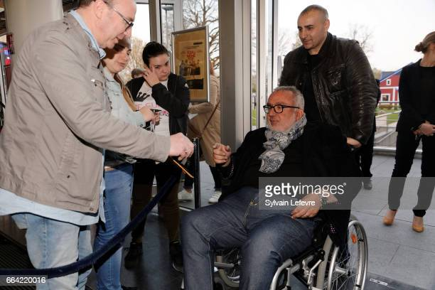 Director Dominique Farrugia signs autographs before 'Sous Le Meme Toit' Premiere at Kinepolis on April 3 2017 in Lille France