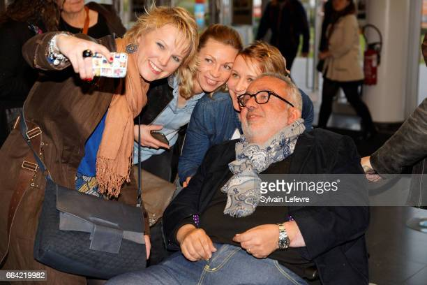 Director Dominique Farrugia takes selfies with fans before 'Sous Le Meme Toit' Premiere at Kinepolis on April 3 2017 in Lille France