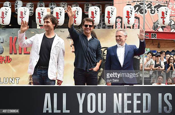 Director Doug Liman Tom Cruise and producer Erwin Stoff attend the promotional event for 'Edge of Tomorrow' at the Dotonbori Riverside on June 26...