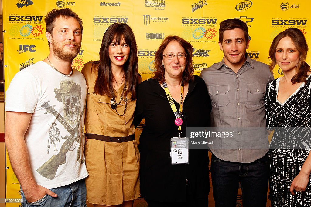 Director <a gi-track='captionPersonalityLinkClicked' href=/galleries/search?phrase=Duncan+Jones+-+Film+Director&family=editorial&specificpeople=7554328 ng-click='$event.stopPropagation()'>Duncan Jones</a>, actress <a gi-track='captionPersonalityLinkClicked' href=/galleries/search?phrase=Michelle+Monaghan&family=editorial&specificpeople=213746 ng-click='$event.stopPropagation()'>Michelle Monaghan</a>, Producer of SXSW Janet Pierson and actors <a gi-track='captionPersonalityLinkClicked' href=/galleries/search?phrase=Jake+Gyllenhaal&family=editorial&specificpeople=201833 ng-click='$event.stopPropagation()'>Jake Gyllenhaal</a> and <a gi-track='captionPersonalityLinkClicked' href=/galleries/search?phrase=Vera+Farmiga&family=editorial&specificpeople=227012 ng-click='$event.stopPropagation()'>Vera Farmiga</a> attend the 2011 SXSW Music, Film + Interactive Festival 'Source Code' Premiere at Paramount Theater on March 11, 2011 in Austin, Texas.