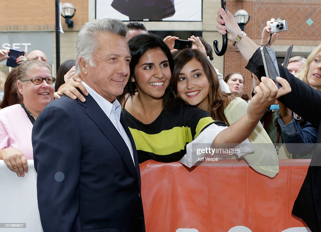 Director Dustin Hoffman poses for a photo with a fan the 'Quartet' premiere during the 2012 Toronto International Film Festival at The Elgin on...