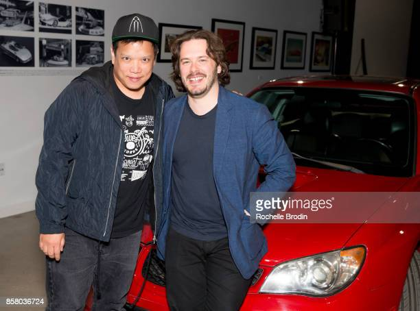Director Edgar Wright and DJ Kid Koala pose with a Subaru at the 'Cars Arts Beats A Night Out With 'Baby Driver'' event at the Petersen Automotive...