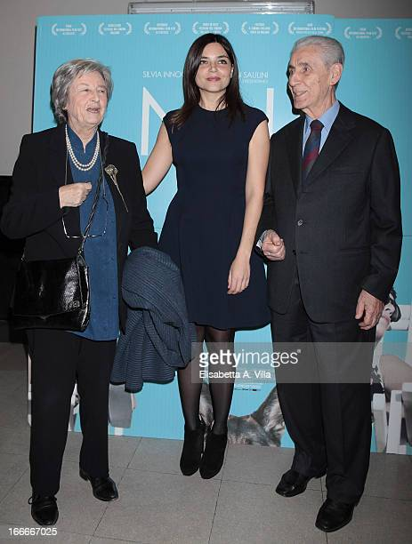 Director Elisa Fuksas poses with Stefano Rodota and his wife during the 'Nina' premiere at Cinema Barberini on April 15 2013 in Rome Italy