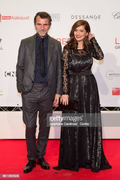 Director Eric Lartigau and actress Marina Golbahari attend the Opening Ceremony of the 9th Film Festival Lumiere on October 14 2017 in Lyon France