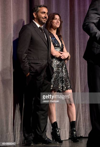 Director Eric Toledano and actress Charlotte Gainsbourg attend the 'Samba' premiere during the 2014 Toronto International Film Festival at Roy...