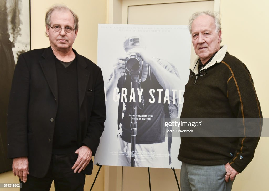 Director Erik Nelson (L) and screenwriter Werner Herzog pose for portrait at the 'A Gray State' Los Angeles special screening and Q+A at Raleigh Studios on November 14, 2017 in Los Angeles, California.