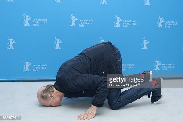 Director Erik Poppe kisses the pavement at the 'The King's Choice' photo call during the 67th Berlinale International Film Festival Berlin at Grand...