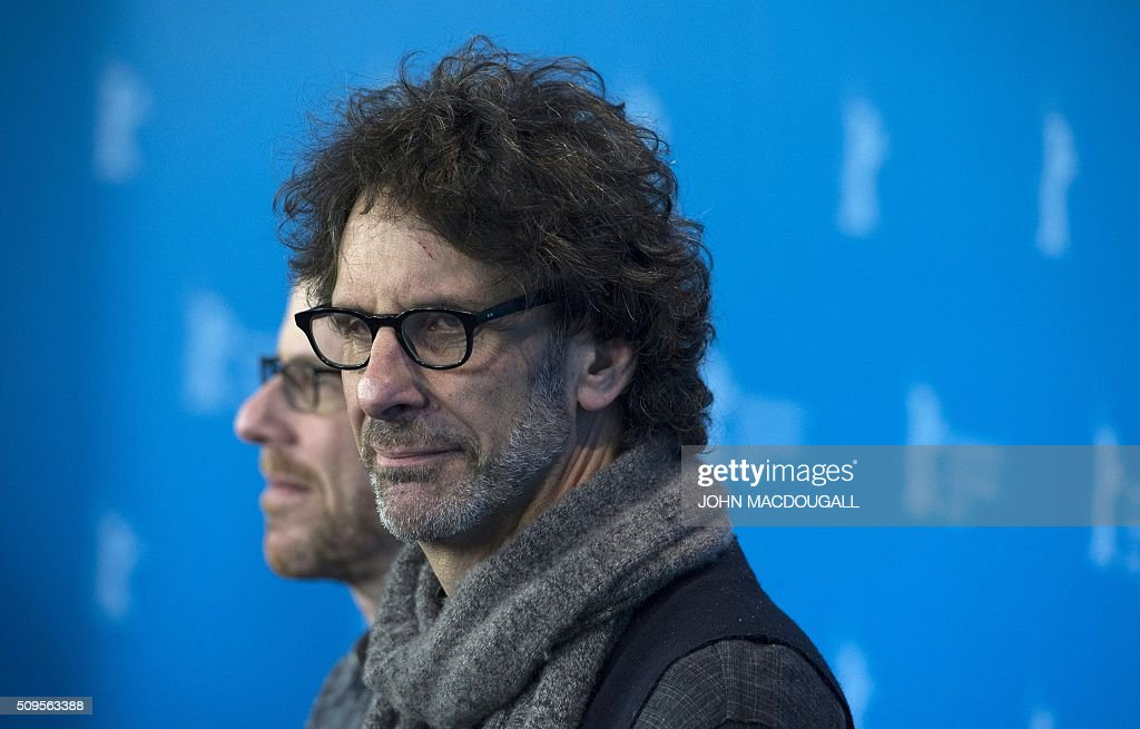 US director Ethan Coen and US director Joel Coen arrive for a photocall for the film 'Hail, Caesar!' screened as opening film of the 66th Berlinale Film Festival in Berlin on February 11, 2016. The 66th Berlin film festival starts on February 11, 2016 with a spotlight on Europe's refugee crisis. / AFP / John MACDOUGALL