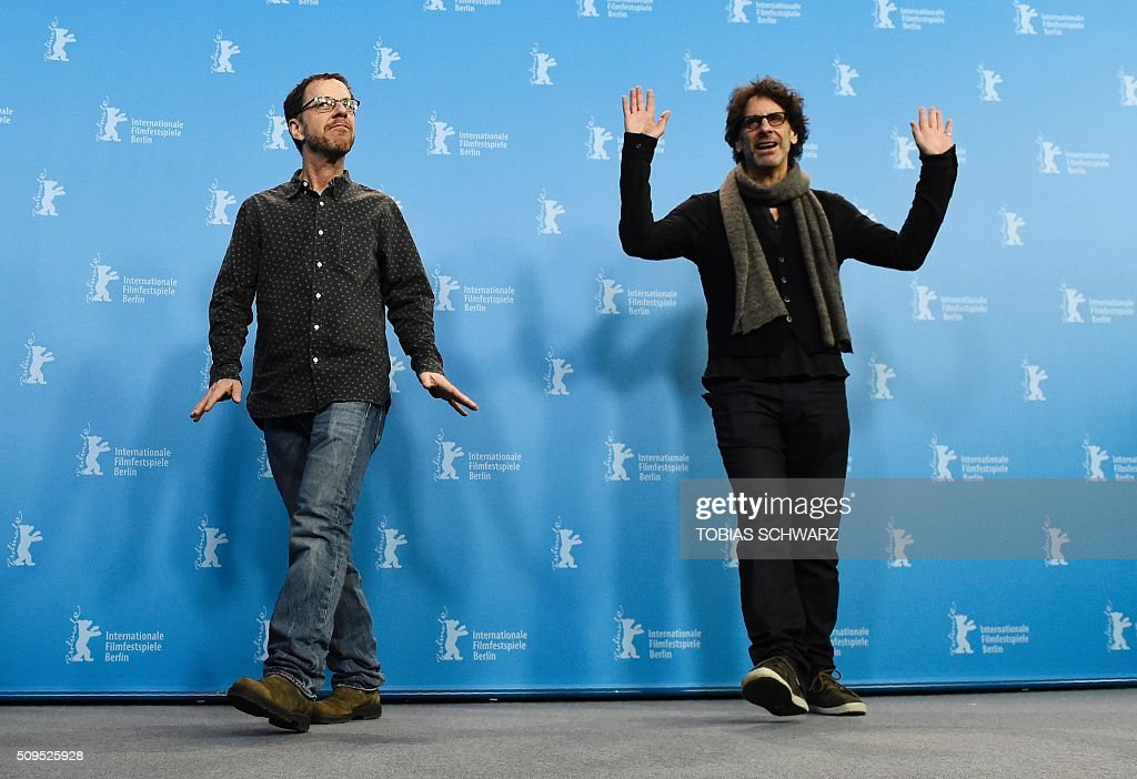US director Ethan Coen (L) and US director Joel Coen pose during the photo call for the film 'Hail, Caesar!' screened as opening film of the 66th Berlinale Film Festival in Berlin on February 11, 2016. The 66th Berlin film festival starts on February 11, 2016 with a spotlight on Europe's refugee crisis. / AFP / TOBIAS SCHWARZ