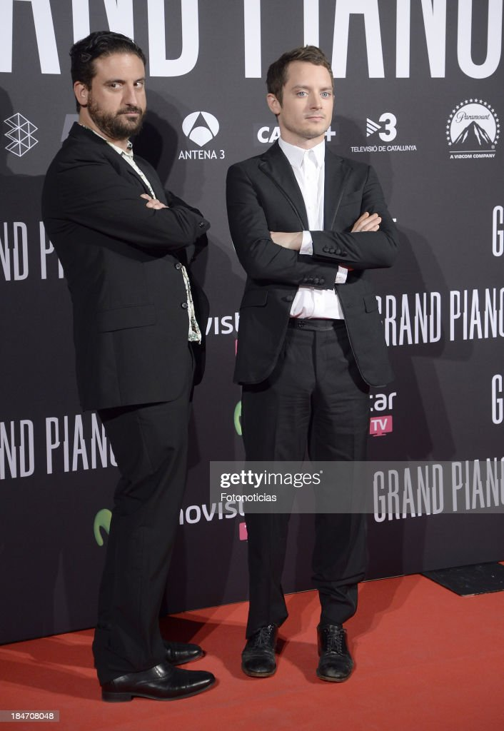 Director Eugenio Mira and actor <a gi-track='captionPersonalityLinkClicked' href=/galleries/search?phrase=Elijah+Wood&family=editorial&specificpeople=171364 ng-click='$event.stopPropagation()'>Elijah Wood</a> attend the premiere of 'Grand Piano' at Capitol cinema on October 15, 2013 in Madrid, Spain.