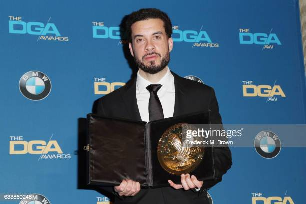 Director Ezra Edelman winner of the Outstanding Directorial Achievement in Documentary for 'OJ Made in America' poses in the press room during the...