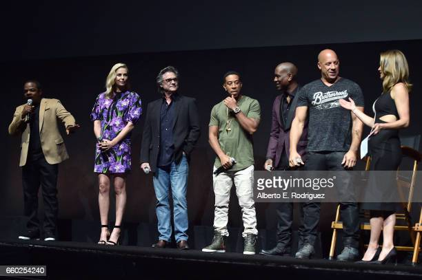 Director F Gary Gray actors Charlize Theron Kurt Russell Ludacris Tyrese Gibson Vin Diesel and moderator Natalie Morales speak onstage at CinemaCon...