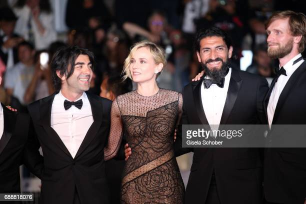 Director Faith Akin Diane Kruger Numan Acar and Ulrich Brandhoff attend the 'In The Fade ' premiere during the 70th annual Cannes Film Festival at...