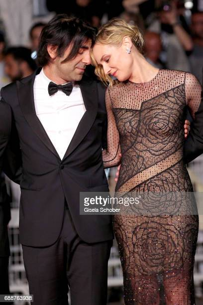 director Fatih Akin and Diane Kruger attends the 'In The Fade ' screening during the 70th annual Cannes Film Festival at Palais des Festivals on May...