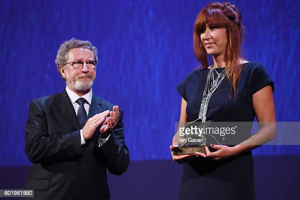 Director Federica Di Giacomo poses with Orizzonti Award for Best Film for 'Liberami' from jury member Robert Guediguian during the closing ceremony...