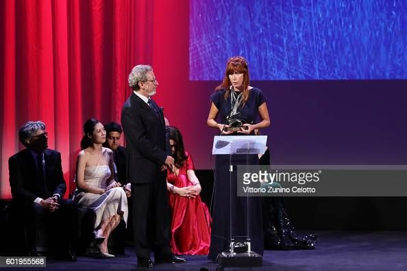 Director Federica Di Giacomo receives the Orizzonti Award for Best Film for 'Liberami' from jury member Robert Guediguian during the closing ceremony...