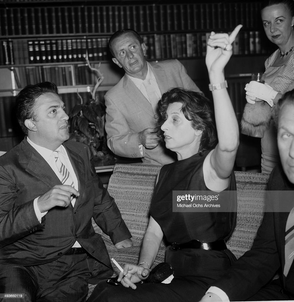 Director <a gi-track='captionPersonalityLinkClicked' href=/galleries/search?phrase=Federico+Fellini&family=editorial&specificpeople=243035 ng-click='$event.stopPropagation()'>Federico Fellini</a> and <a gi-track='captionPersonalityLinkClicked' href=/galleries/search?phrase=Anna+Magnani&family=editorial&specificpeople=241458 ng-click='$event.stopPropagation()'>Anna Magnani</a> at his cocktail party in Los Angeles, California.
