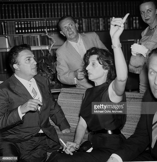 Director Federico Fellini and Anna Magnani at his cocktail party in Los Angeles California
