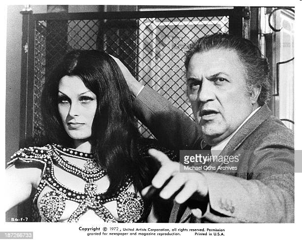 Director Federico Fellini with actress Fiona Florence behind the scenes of the United Artist movie 'Fellini's Roma' in 1972
