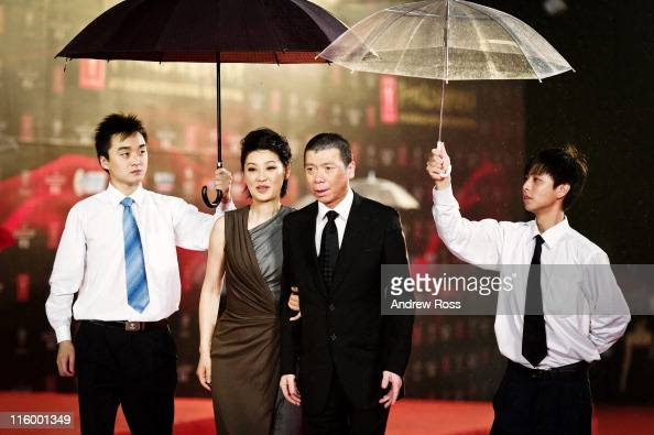 Director Feng Xiaogang and his wife Xu Fan arrive at the opening ceremony of the 14th Shanghai International Film Festival on June 11 2011 in...