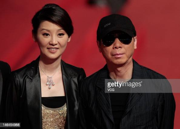Director Feng Xiaogang and his wife Xu Fan arrive at the red carpet during the opening ceremony for the 15th Shanghai International Film Festival at...
