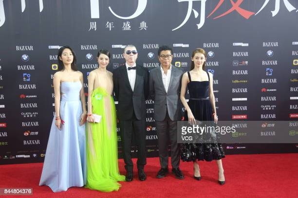 Director Feng Xiaogang arrives at the red carpet of 2017 Bazaar Star Charity Night on September 9 2017 in Beijing China