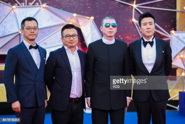 Director Feng Xiaogang arrives at the red carpet of the closing ceremony of the 26th China Golden Rooster Hundred Flowers Film Festival on September...