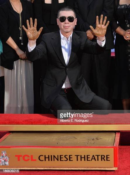Director Feng Xiaogang attends a ceremony immortalizing him with a hand and footprint at TCL Chinese Theatre IMAX on November 1 2013 in Hollywood...