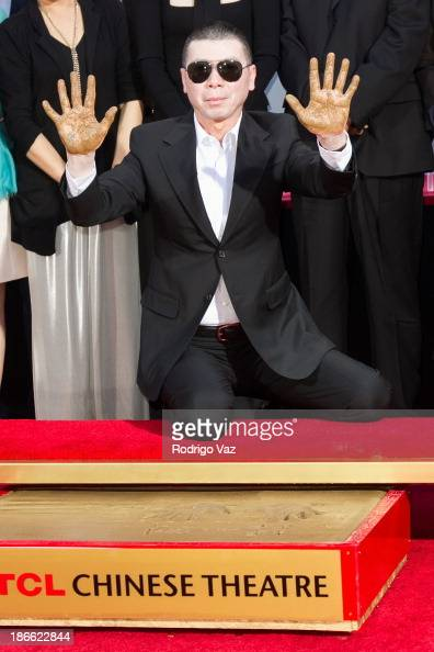 Director Feng Xiaogang attends a ceremony immortalizing him with hand and footprints at TCL Chinese Theatre at TCL Chinese Theatre on November 1 2013...