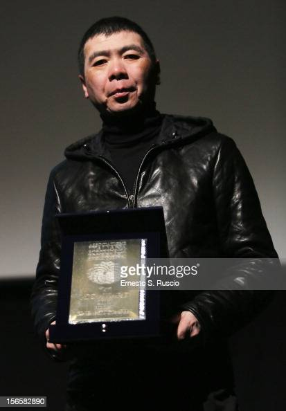 Director Feng Xiaogang poses on stage with Farfalla D'oro Agis Scuola award during the Collateral Awards Ceremony at the 7th Rome Film Festival at...