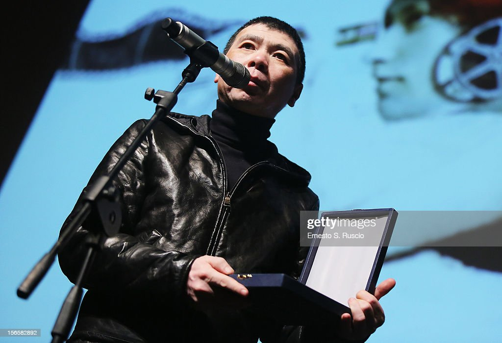 Director <a gi-track='captionPersonalityLinkClicked' href=/galleries/search?phrase=Feng+Xiaogang&family=editorial&specificpeople=537488 ng-click='$event.stopPropagation()'>Feng Xiaogang</a> poses on stage with Farfalla D'oro Agis Scuola award during the Collateral Awards Ceremony at the 7th Rome Film Festival at the Auditorium Parco Della Musica on November 17, 2012 in Rome, Italy.