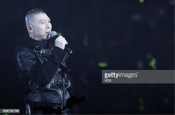 Director Feng Xiaogang who wins the Best Leading Actor of the 52nd Golden Horse Film Awards in Taipei performs onstage during the 'Mr Six' Concert at...