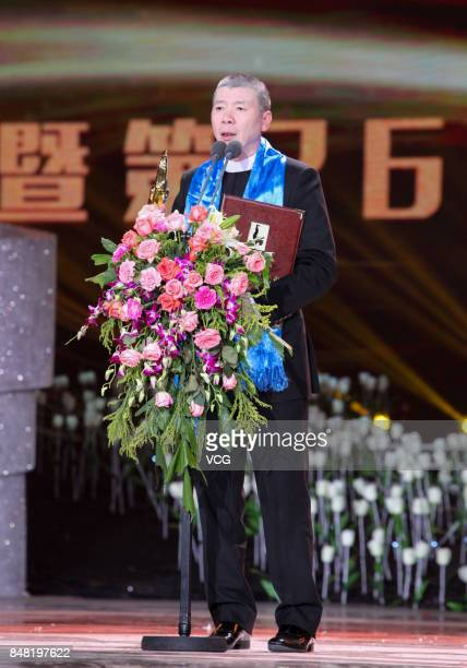 Director Feng Xiaogang wins the Best Director award of the Golden Rooster Awards during the closing ceremony of the 26th China Golden Rooster and...
