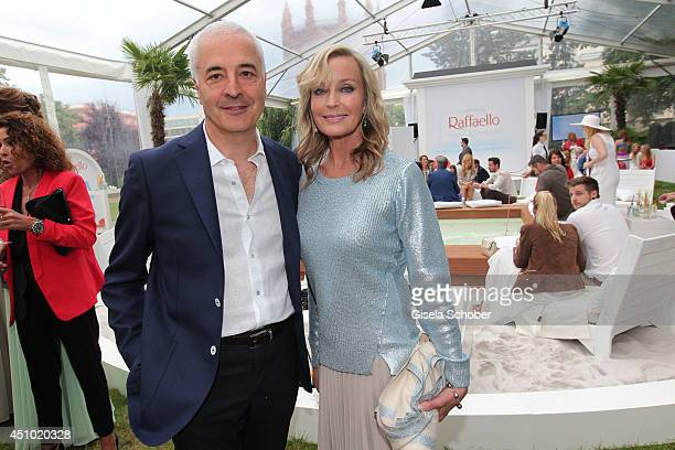 Director Ferrero Germany Carlo Vassallo and Bo Derek attend the Raffaello Summer Day 2014 at Kronprinzenpalais on June 21 2014 in Berlin Germany