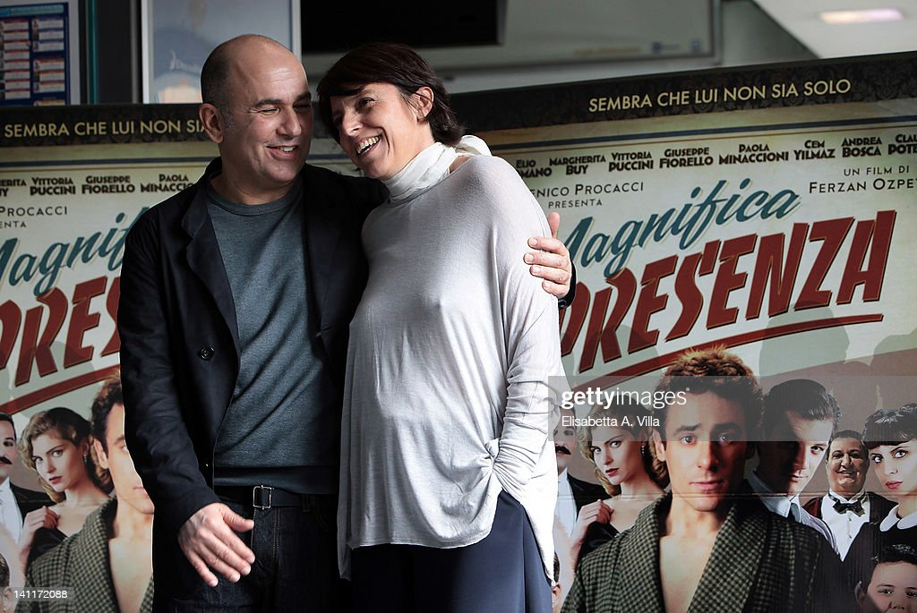 Director Ferzan Ozpetek (L) and screenwriter Federica Pontremoli attend 'Magnifica Presenza' photocall at Adriano Cinema on March 12, 2012 in Rome, Italy.