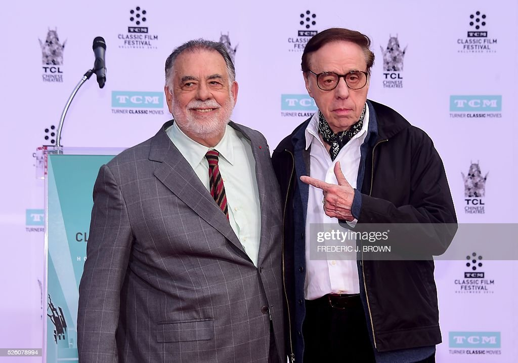 Director Francis Ford Coppola poses with fellow director Peter Bogdanovich (R) at his Hand and Footprint Ceremony in front of the TCL theater in Hollywood, California on April 29, 2016. The US film director was honored as part of the 2016 TCM Classic Film Festival. / AFP / FREDERIC